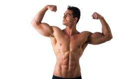 Przystojny bodybuilder robi klasyków bicepsów dwoistej pozie Zdjęcie Royalty Free