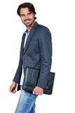 Przystojny elegancki mężczyzna niesie teczkę Obraz Royalty Free
