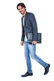 Przystojny elegancki mężczyzna niesie teczkę Zdjęcia Stock