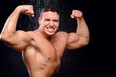 Przystojny facet bierze prysznic Obraz Stock