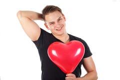 Przystojny facet trzyma sercowatego balon zdjęcia stock