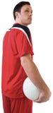 Przystojny gracz futbolu trzyma piłkę Zdjęcie Royalty Free