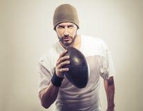 Przystojny gracz futbolu z piłką Zdjęcia Stock