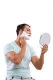 Przystojny mężczyzna golenie odizolowywający na białym tle Obraz Stock