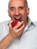 Przystojny mężczyzna je jabłka Zdjęcie Royalty Free