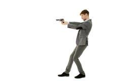 Przystojny mężczyzna używa pistolet Zdjęcia Royalty Free