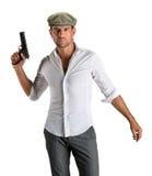 Przystojny mężczyzna w nakrętce z pistoletem Obraz Stock