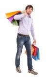 Przystojny mężczyzna z torba na zakupy Fotografia Stock