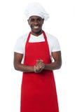 Przystojny męski szef kuchni odizolowywający na bielu Obraz Stock
