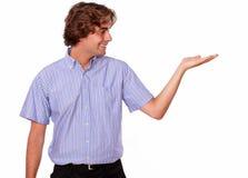 Przystojny młody człowiek trzyma out jego palmy Obraz Royalty Free