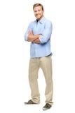 Przystojny młody człowiek zbroi fałdowego pełnego długość bielu tło Zdjęcia Stock