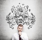 Przystojny młody profesjonalista przewiduje budynek plan biznesowy dla rozwoju biznesu Planu biznesowego nakreślenie rysuje Zdjęcie Stock