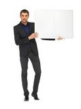 Przystojny mężczyzna w kostiumu z pustą deską Obraz Stock