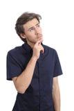 Przystojny poważny mężczyzna główkowanie i patrzeć stronę Obrazy Stock