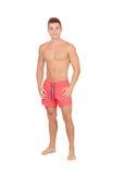 Przystojny ratownik z czerwonym swimsuit Zdjęcia Stock