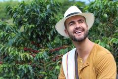 Przystojny rolnik w kawowej plantacji zdjęcia stock