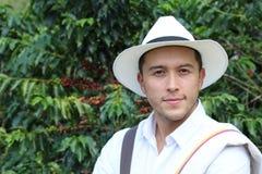 Przystojny rolnik w kawowej plantacji obraz stock