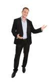 Przystojny szczęśliwy odosobniony młody biznesmen przedstawia z rękami Zdjęcia Royalty Free
