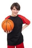 Przystojny uśmiechnięty gracz koszykówki Zdjęcia Stock