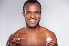 Przystojny z stomatologicznym floss. Zdjęcie Royalty Free