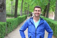 Przystojny zdrowy męski ono uśmiecha się w parku Zdjęcie Royalty Free