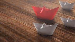 Przyw?dctwo poj?cie z czerwie? papieru statkiem prowadzi w?r?d bielu na nieociosanym drewnianym tle zdjęcie royalty free