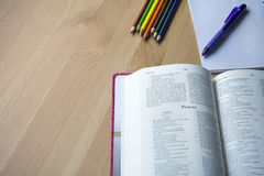 Psalm Bible study with pen. Bible study with pen and pencil for bible study on desk with phone Royalty Free Stock Photos