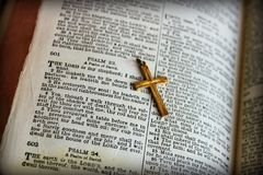 Psalms 23 Bible. A vintage Bible opened to the 23rd Psalms with a golden cross Stock Images