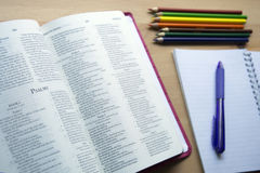 Psalms bible study with pen. Bible study with pen and pencil for bible study on desk Royalty Free Stock Photos