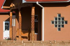 Pseudo-adobe house. Adobe-like house with red roof Royalty Free Stock Images