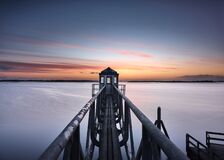 Pseudo-lighthouse at a silent lake just before dawn