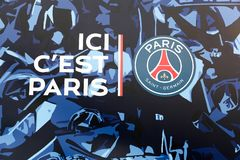 PSG logo and slogan on the wall of Parc des Princes, France. Paris, France - March 28 2016: PSG logo and slogan on the wall of Parc des Princes. Paris Saint Stock Photo