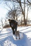 Psi bieg jego właściciel Fotografia Royalty Free