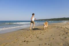 psia dziewczyno grać young Zdjęcia Stock