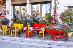 Cafeteria with red and yellow tables and chairs at Psirri neighborhood Athens Greece stock photography