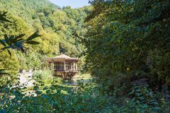 The Psirtskha Railway Station of the old railway in Abkhazia. View from the opposite shore of the river. NEW ATHOS, ABKHAZIA, GEORGIA, 19 SEPTEMBER 2017: The Stock Photo