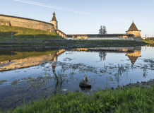 Pskov Kremlin from the side of the Pskova river at sunrise. Royalty Free Stock Image