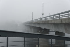Pskov, misty morning , river and the bridge, shrouded in fog Royalty Free Stock Images