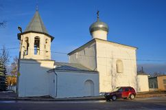 Pskov, Russia, December, 31, 2017. Red car near the church of the Intercession from the marketplace Pokrova na Torgu, 17th centu royalty free stock photos