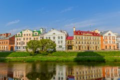 Pskov, Russia. View of the old street by the river in the center of the city with reflection in the water. Pskov, Russia Stock Photos