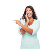 Pssst did You Hear that?. Laughing Woman Smiling and pointing, telling a Secret Royalty Free Stock Photography