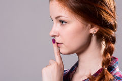 Psst - a beautiful girl with pigtails making a shushing gesture Royalty Free Stock Images