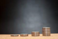 PStacks των νομισμάτων Η αύξηση στα χρήματα Στοκ Φωτογραφία
