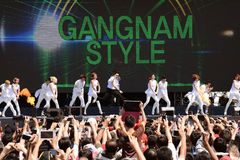 PSY Gangnam Style. Performers dance dancing Gangnam Style on asian road show Stock Photo