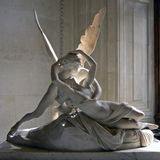 Psyche and Cupid. (Eros) in the Louvre, Paris; this statue shows Cupid bringing Psyche back to life after she was killed in a jealous rage by his mother, Venus royalty free stock photo
