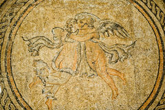 Psyche and eros mosaic. An ancient mosaic representing the romance between Psyche and eros in the gardens surrounding the alcazar de los Reyes Cristianos in Stock Images