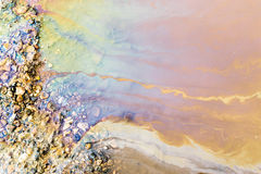 Psychedelic Abstract of Toxic Oil Pollution on Water Royalty Free Stock Images