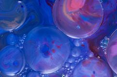 Psychedelic art background. Abstract patterns made by paint, milk and soap. stock photo