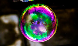 Psychedelic Bubble. Bubble photography with psychedelic rainbow colors after processed in PS CC to enhance details colors and contrast Royalty Free Stock Photos