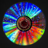 Psychedelic CD. Light clo0urfull reaction stock photo